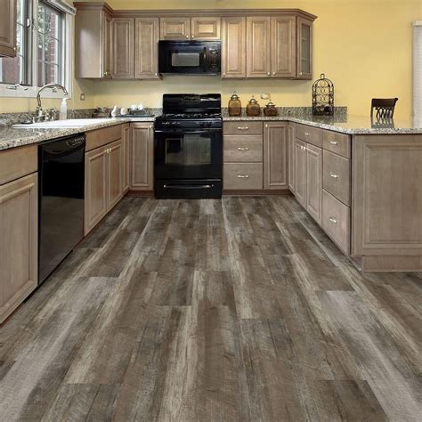 home depot kitchen flooring wide 8 7 in x 47 6 in easy rustic beige resilient vinyl plank flooring the home depot home