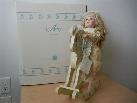 porcelain doll in wooden box vintage porcelain doll with wooden rocking and