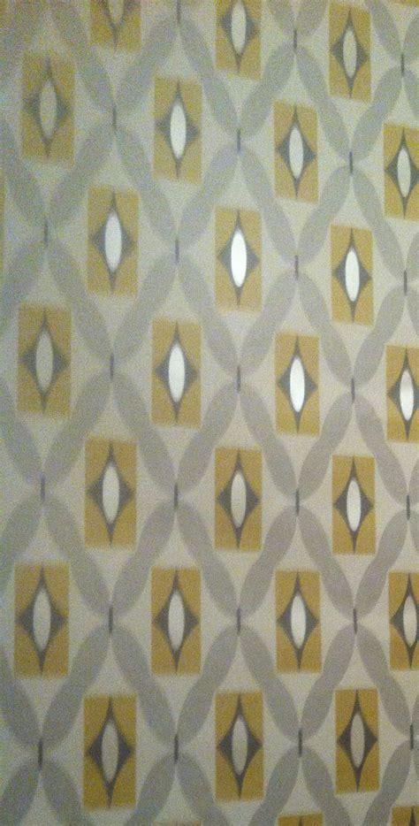 b q grey wallpaper feature wall grey and mustard geometric print wallpaper