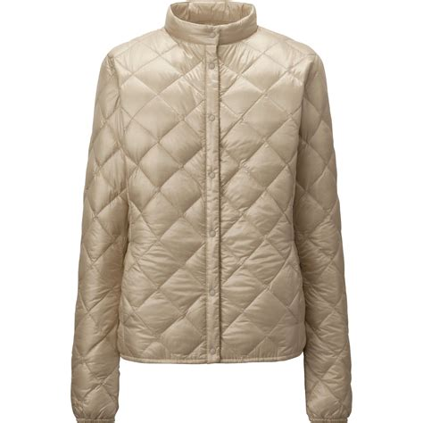 uniqlo women ultra light down parka uniqlo ultra light down compact quilted jacket in beige lyst