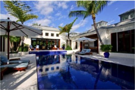 Jimmy Homes by Jimmy Buffett Buys Palm Home