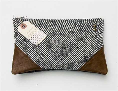 image of sold out black white diagonal stripe clutch