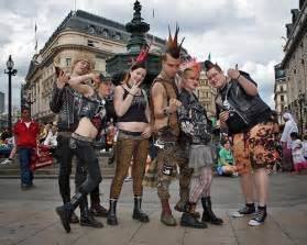 Uk punks displaying elements of early and 1980s punk fashions circa