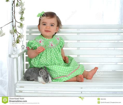 baby bunny swing baby and rabbit on swing royalty free stock photo image