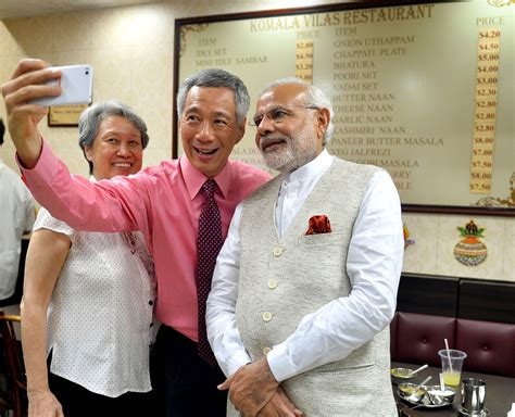 li xiuqi lee hsien loong file pm lee hsien loong of singapore takes a selfie with