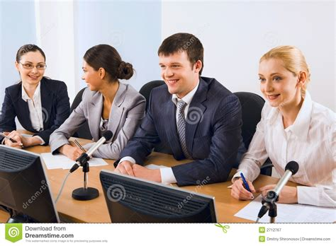 Sitting In Chair In Front Of Speaker by Before The Conference Royalty Free Stock Photography