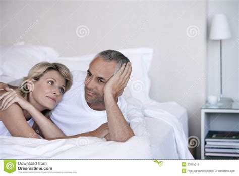 romantic couple in bedroom romantic couple relaxing on bed royalty free stock photo