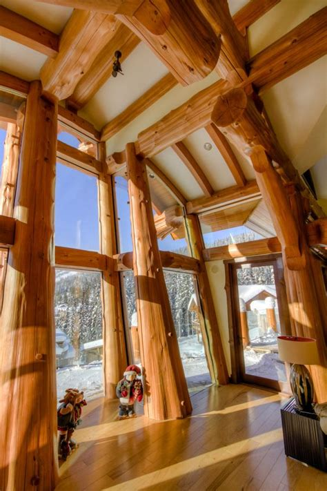 log house roofs with wooden beams cedar post and beam curved timber roof glass forest