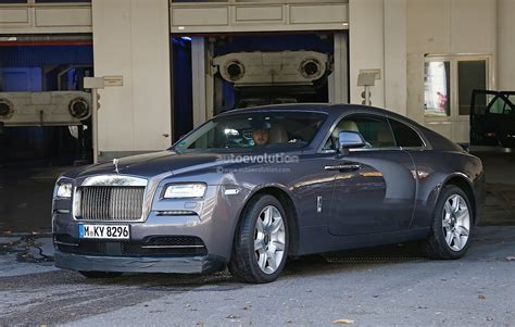 rolls royce sports car rolls royce wraith sport spied wearing massive spoilers