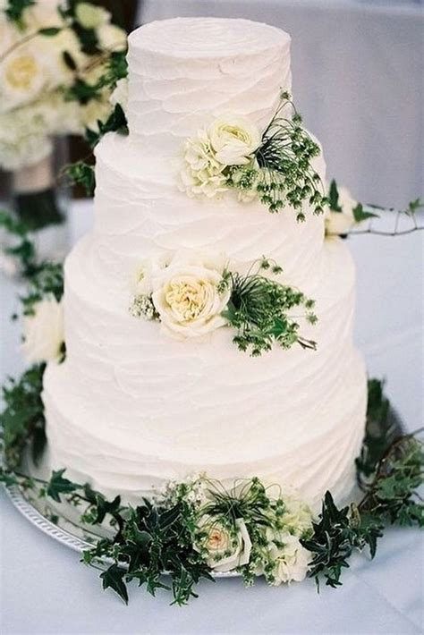 simple romantic white buttercream wedding cake with roses