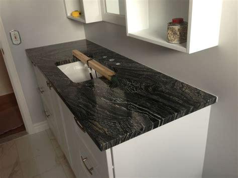 silver wave granite kitchen counters and backsplash