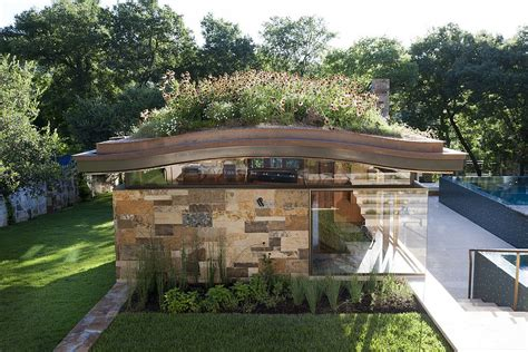 living roofs pool house with a curved living roof makes a bold green