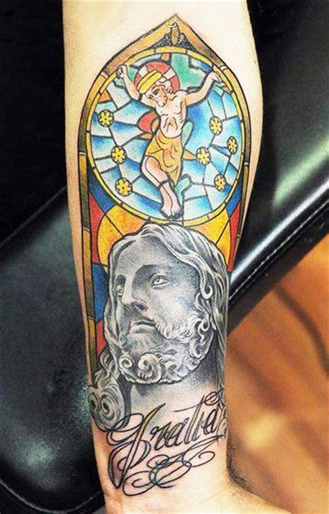 jesus crucifixion tattoo coloured crucifixion of jesus forearm