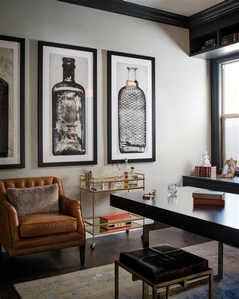 single man home decor a glass and gold bar cart brown leather armchair and