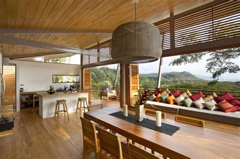 Style Of Homes maison bois salon cuisine