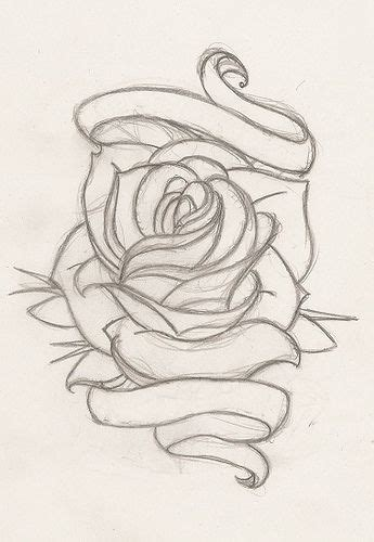 rose tattoos with ribbon with my and dads name in the ribbon i