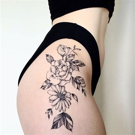 small flower tattoo on hip floral hip done by the lovely helen xu at golden