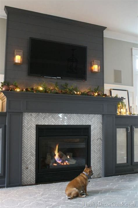 Fireplace Mantel Height With Tv Above by Plank Of Wood Herringbone Tile And Fireplaces On
