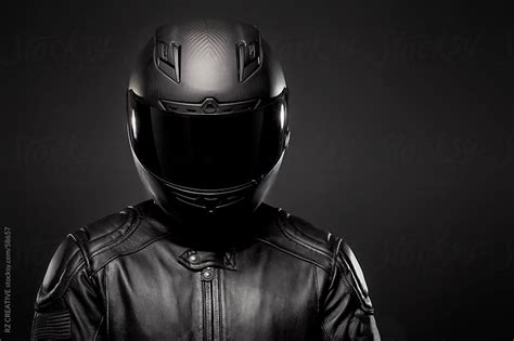 motorcycle helmets and jackets wearing a black leather motorcycle jacket and helmet