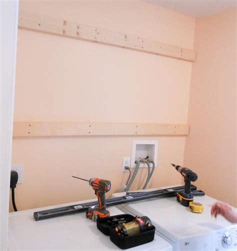 how to hang kitchen wall cabinets tips for hanging wall cabinets projects by zac