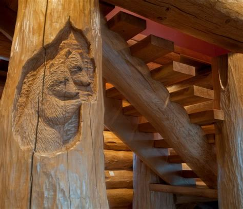 wood scow a pair of bear s relief carved as a subtle detail on the
