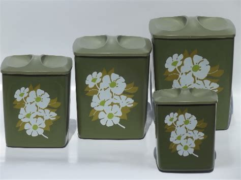 60s retro plastic canisters white flowers on avocado