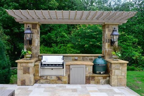 outdoor kitchen with green egg a weber grill and big green egg a ceramic cooker are key components of the outdoor kitchen