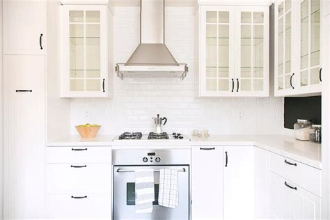 White Kitchen Cabinets With Glass White Beadboard Kitchen Cabinets With Beveled Subway Backsplash Tiles Transitional Kitchen