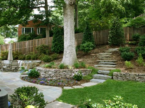 how to landscape a sloped backyard retaining wall with stone path on sloped backyard