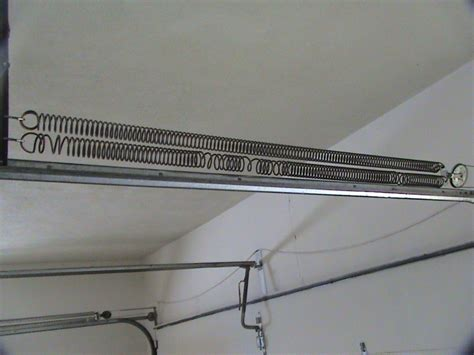 An Overhead Garage Door Has Two Springs by Home Inspection Blair Nebraska Damaged Garage Door