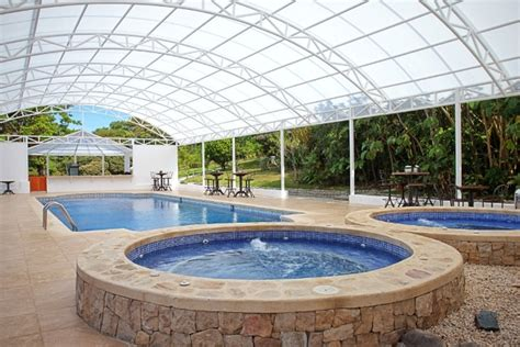 Swimming Pool Awnings by Swimming Pool Canopy Rainwear