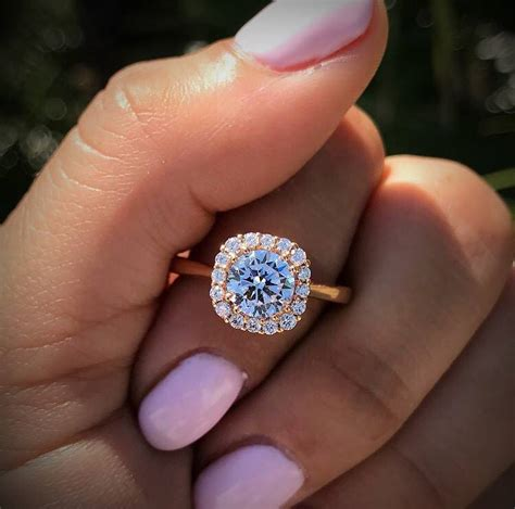 solitaire  halo engagement ring comparison raymond lee