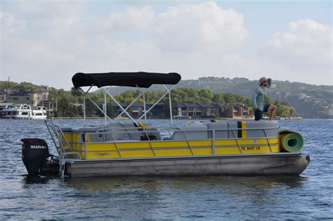 lake travis boat rentals with captain 22ft yellow bentley pontoon with a floaton captain and a