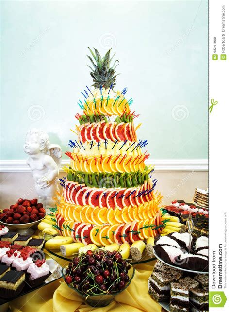 fruit pyramid decoration cakes and cookies at dessert