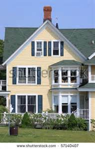 light yellow house front of a yellow house and blue sky stock photo 57140407