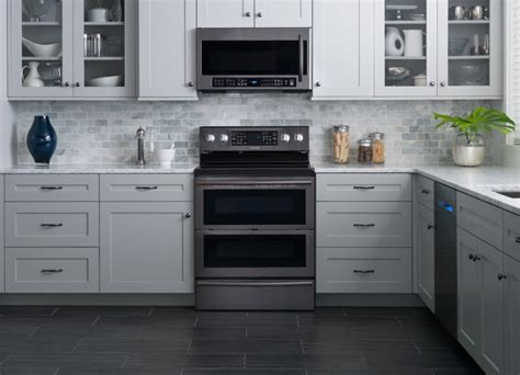 black kitchen cabinets with stainless steel appliances samsung releases all black stainless steel kitchen