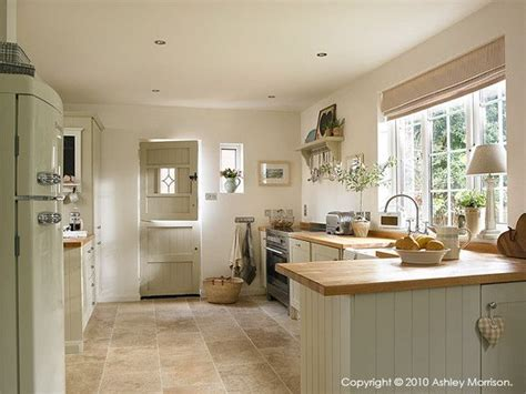 country kitchen cupboards painted in farrow and shaded white a soft neutral tone with a