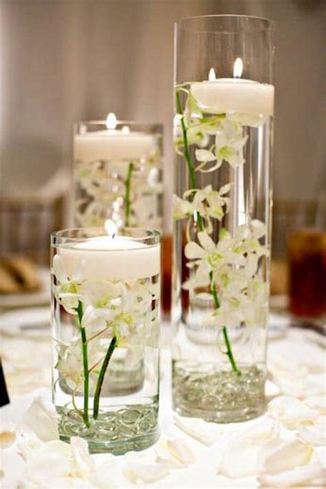 Cylinder Vases With Floating Candles And Flowers by 20 Impossibly Floating Wedding Centerpieces