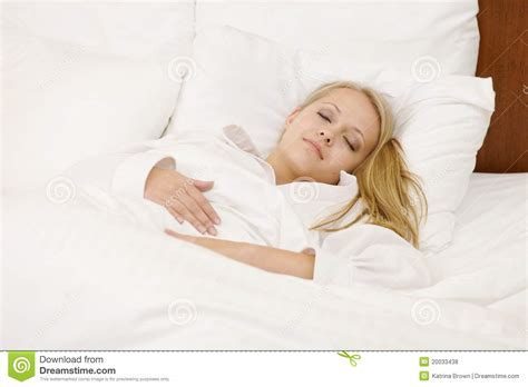 lying in my bed peaceful woman lying in bed resting at home royalty free