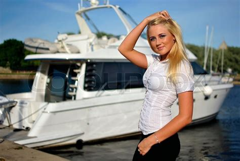 girls on boats portrait of blonde girl in a white shirt against the boat