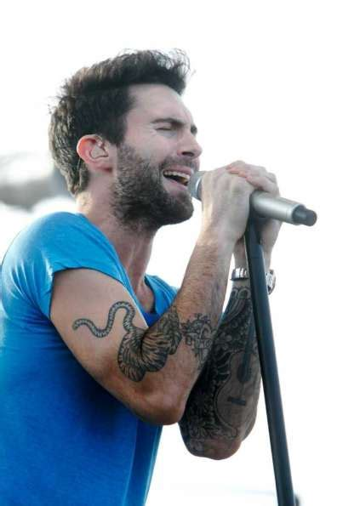 maroon 5 singer maroon 5 lead singer adam levine performs during a concert