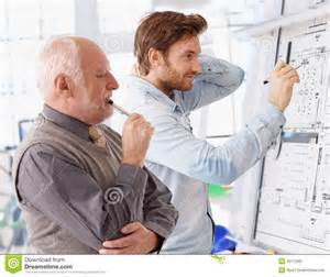 designers and architects young and senior architects working together stock image image 35112981