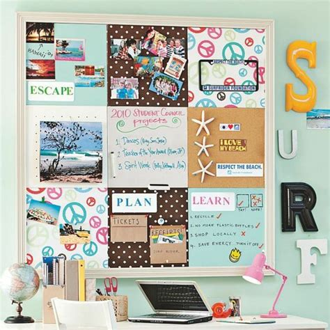 a inspired pinboard above a room desk adds