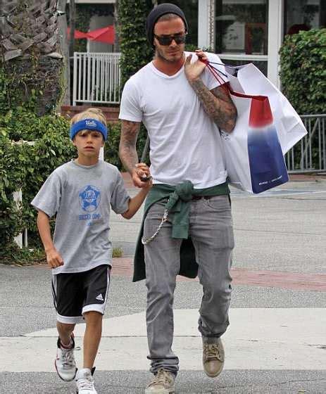 romeo beckham style father and son bonding romeo beckham takes style tips