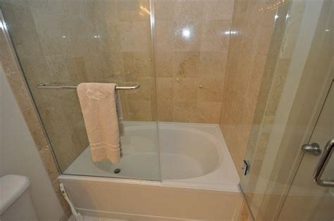 short bathtub shower bathroom soaker tub shower combo with folding glass