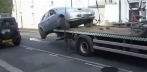 Bad Tow Truck Driver by Moron Drives Flatbed Tow Truck To Avoid Parking Ticket