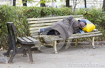 homeless man on bench homeless man sleeping on a bench editorial image image
