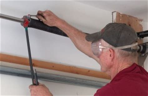 How To Replace Garage Door Torsion Springs Tightening Garage Door Springs
