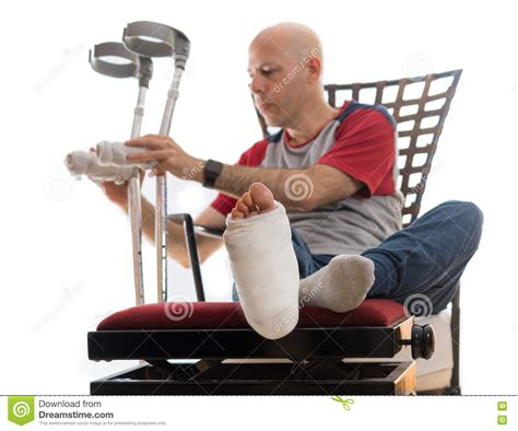 the couch cast young man with a broken ankle and a leg cast stock photo