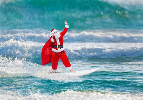 santa on surfboard santa claus windsurfer with gifts sack surfing at waves stock image image of sack